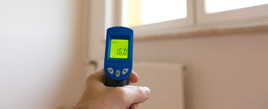 Infrared thermometer being used in a home
