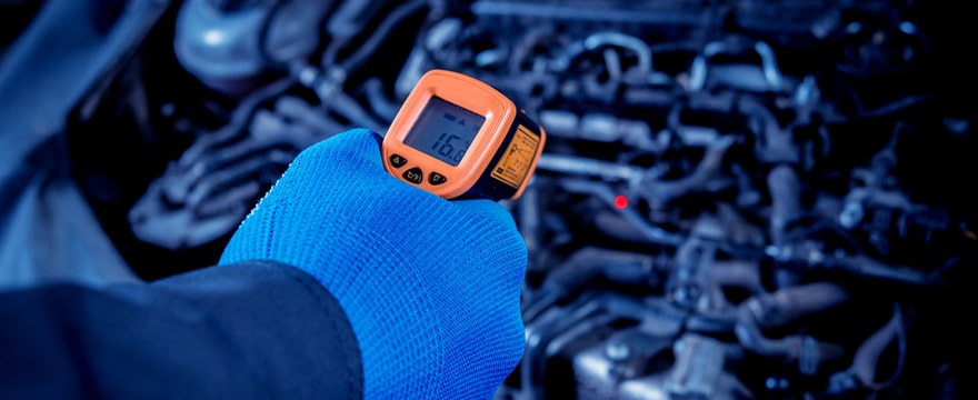 IR thermometer diagnosing a vehicle