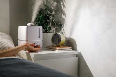 Humidifier positioned in bedroom on table
