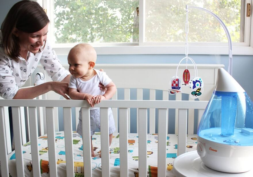 Humidifier in a nursery with baby and mom