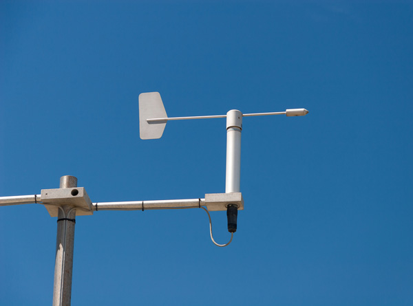Wind vane being used to measure wind direction