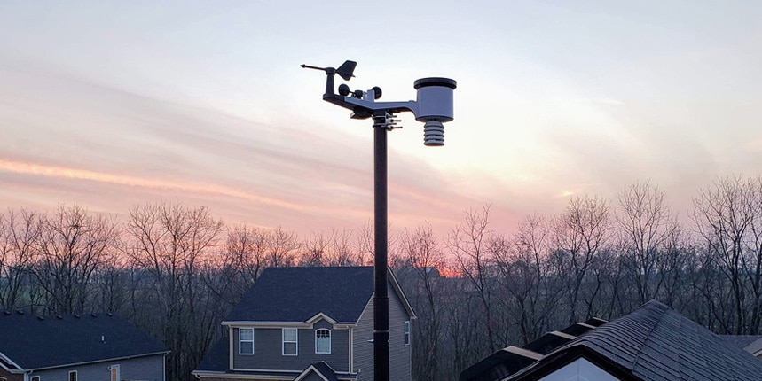 Ambient Weather WS-2902C installed on the roof of a house