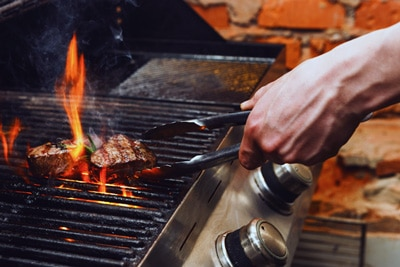 Check a grill's temperature with an infrared thermometer