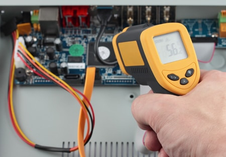 Infrared thermometer measuring a circuit board