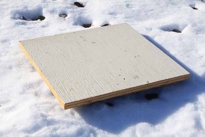 Snowboard being used to measure snow